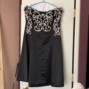 Black dress with off-white embellishments